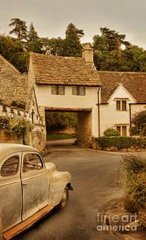 Jill Battaglia - Vintage Car Driving Through Village
