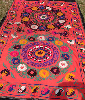Vintage Central Asian Susani tapestry featuring embroidery on cotton background by Uzbek embroidery artist