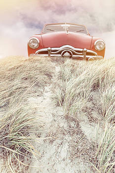 Edward Fielding - Vintage red car in the sand dunes