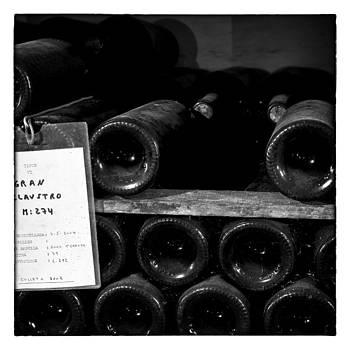 Nicole Neuefeind - Vintage wine bottles in cellar