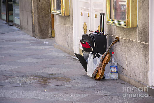 Violin in the street by Stefano Piccini