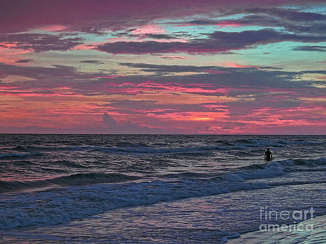 Watching The Sanibel Sunset by Jeff Breiman