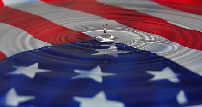 Water and American Flag by Mischelle Lorenzen