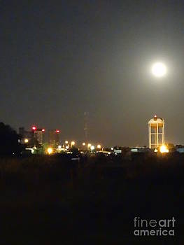 Water Tower Town At Night by Joseph Baril