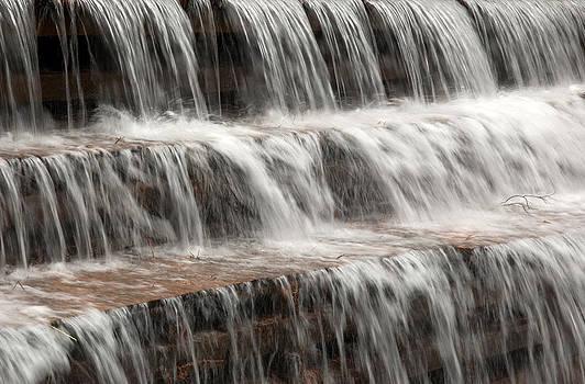 Waterfall over a dam on Waba Creek. by Rob Huntley