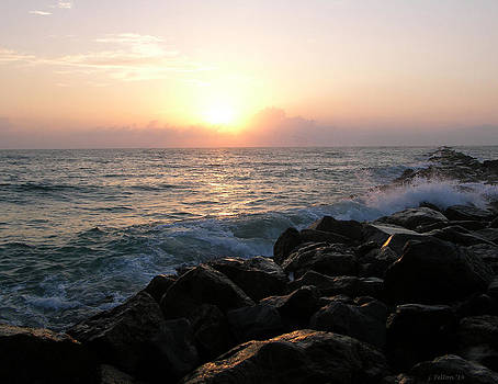 Waves on the jetty at sunrise by Julianne Felton