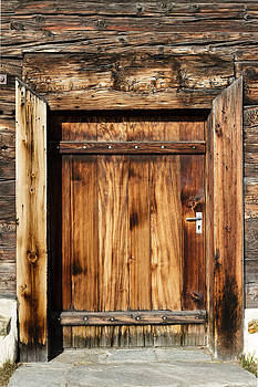 Weathered building by Charles Lupica
