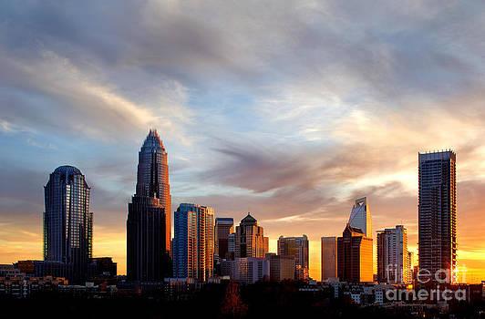 Whispy clouds over Charlotte NC skyline by Patrick Schneider