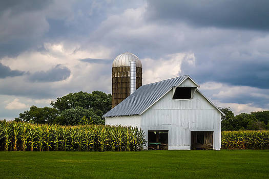 Ron Pate - White Barn and Silo with Storm Clouds
