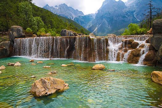 White Water River waterfall at Lijiang Yunnan China by Calvin Chan