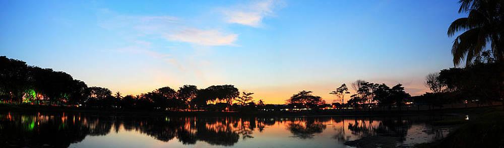 Wide lake reflection at dusk. by Calvin Chan