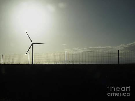 BERNARD JAUBERT - Wind power against a threatening sky