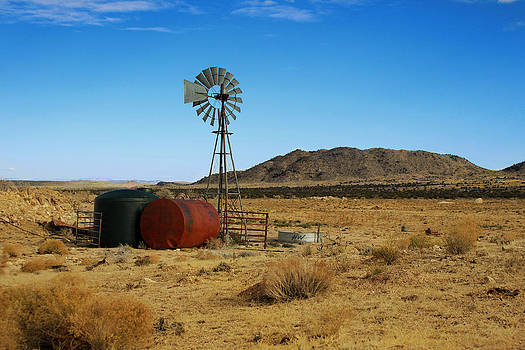 Windmill in the desert by Daniela Safarikova