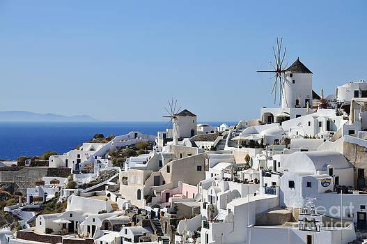 George Atsametakis - Windmills and white houses in Oia