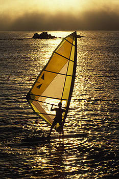 Windsurfer Against Sunset And Seafog by Austin Brown