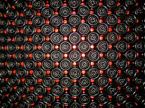 Wine Bottles stacked on each other by Jennifer Lamanca Kaufman