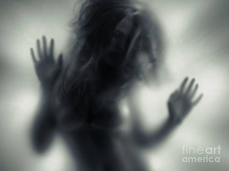 Woman blurred silhouette behind glass by Oleksiy Maksymenko