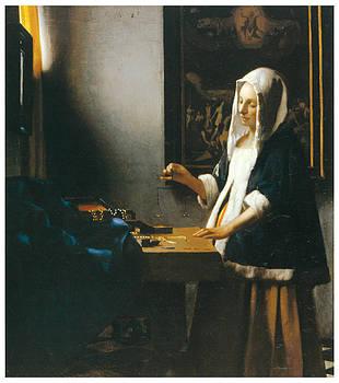 Johannes Vemeer - Woman Holding a Balance