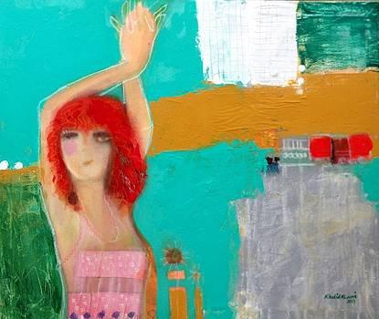 Woman in a city  by Khalid Alaani