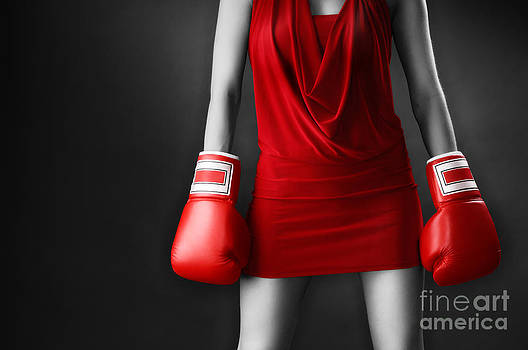 Woman in sexy red dress wearing boxing gloves by Oleksiy Maksymenko