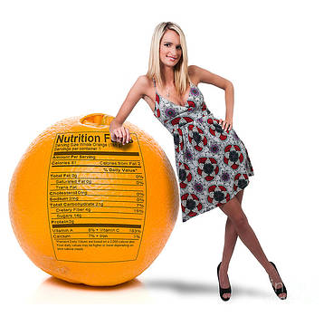 Woman Leaning on Orange with Nutrition Label by Rob Byron