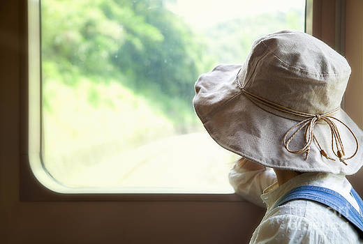 Fototrav Print - Woman looking through the train window
