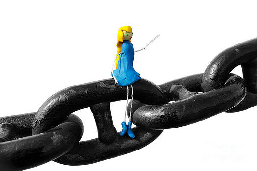 Woman made of plasticine sitting on chain by Alexandr  Malyshev