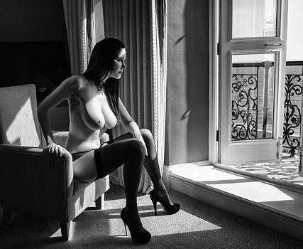 Woman sitting at balcony by Neil Buchan-Grant