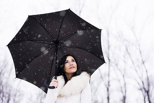 Newnow Photography By Vera Cepic - Woman under umbrella while snowing