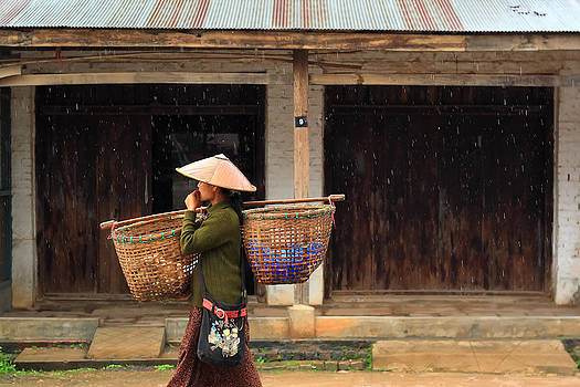 Women Market Walking On Street by Teerawut Punsorn