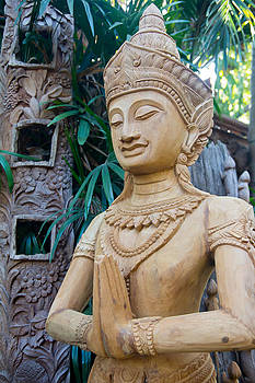 Wood carving  by Kobchai Sukruean