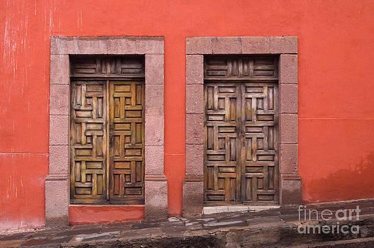 Oscar Gutierrez - Wooden Doors on Orange Wall