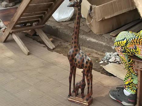 Wooden Giraffe by Hilary Bime