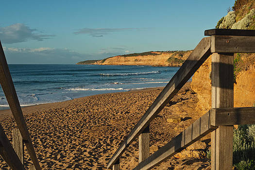 Wooden rail at beach by View Factor Images
