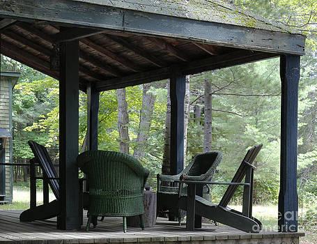 Barbara McMahon - Worn Wicker Chairs on Old Veranda