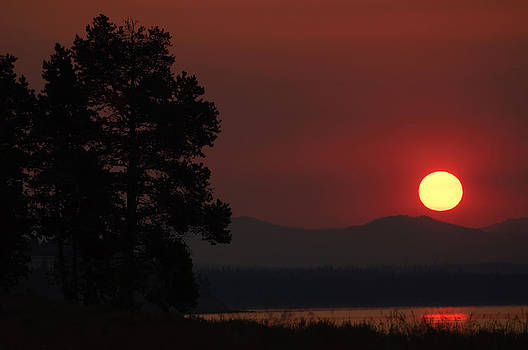 Yellowstone Lake Sunrise on Smoky Day by Bruce Gourley