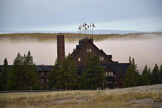Yellowstone's Old Faithful Inn with Morning Fog by Bruce Gourley