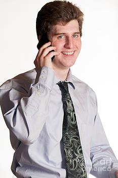 Gunter Nezhoda - young business man on cell phone