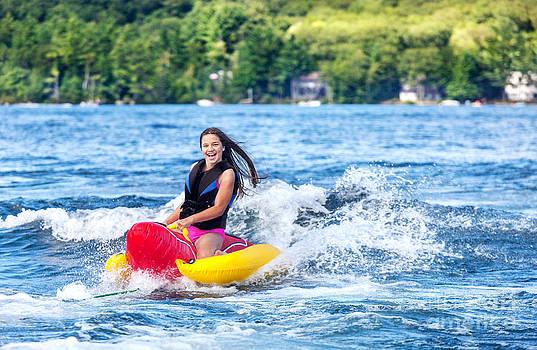 Jo Ann Snover - Young girl enjoys tubing on lake
