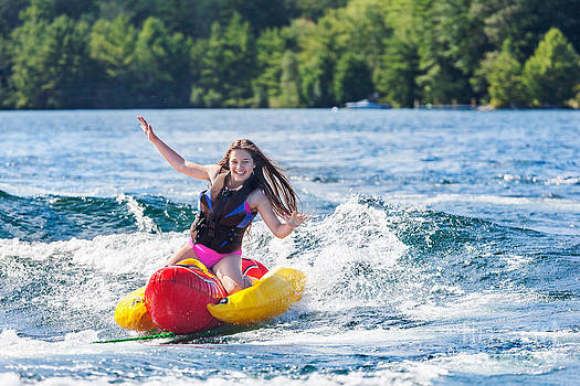 Jo Ann Snover - Young girl lets go of inflatable while tubing