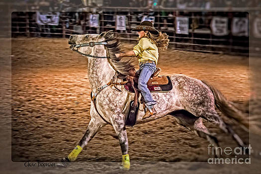 Young lady barrel racer by Char Doonan