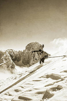 Young Man Is Skiing Down A Steep Slope In Old Nostalgic Skiing Equipment by Leander Nardin