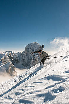 Young Man Is Skiing Down A Steep Slope In Old Nostalgic Skiing  by Leander Nardin
