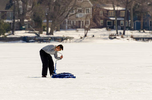 Young Man Opening Up The Ice on Lake Hopatcong by Maureen E Ritter