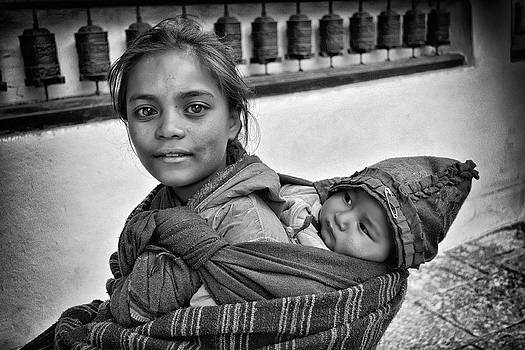 Young mother and child Nepal by Phil Callan Photography