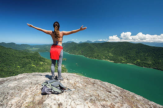 Young Woman On Mountain With Arms by Vitor Marigo