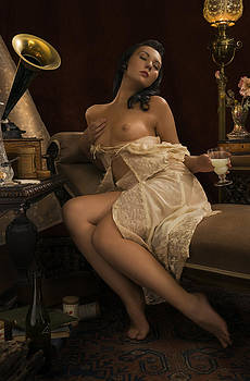 Young woman secluded pleasure of music and absinthe by Damian Hevia