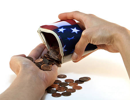American Flag Wallet with Coins and Hands by Blink Images