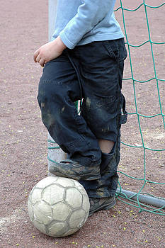 Boy with soccer ball by Matthias Hauser