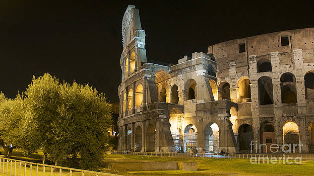 BERNARD JAUBERT - Coliseum  illuminated at night. Rome